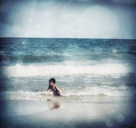 Alek plays with the waveS.. by TreMenda