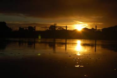 Sun Setting In A Deathly Sea by SebSil
