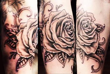 black and grey rose tattoo by Kiartia