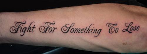 Swirly script tattoo by Kiartia