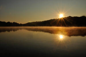 Sunrise over the lake by MikeysPhotos