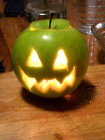 Jack-O-Lantern Apple by happymiserychildren