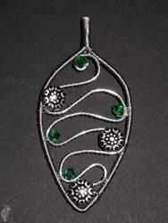 Slytherinish pendant by steelraven