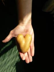 Heart on a hand by AcidBurnL9