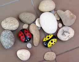 Ladybugs on rocks by AloneInUniverseArt