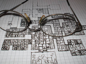 Glasses and map by billmbabblefotostok