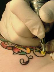 tattoo artist in action 02 by UnderTheBoardwalk