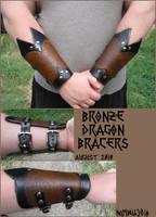 Bronze Dragon Bracers by AThousandRasps