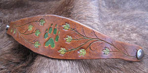Brown and Green Wolf Paw Bracelet by AThousandRasps