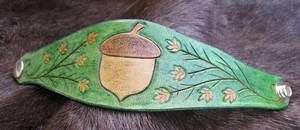 Green and Gold Acorn Bracelet by AThousandRasps
