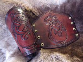 Burgundy Norse Dragon Bracers by AThousandRasps