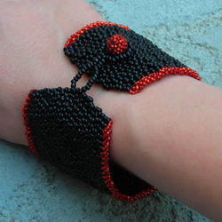 black and red woven beaded bracelet by Polychroia