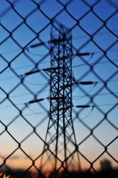 Pylon Behind Fence by LDFranklin