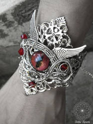 Demon bracelet with red eye cabochon by GothicRosettejewelry