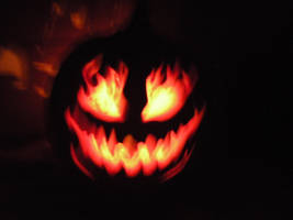 Flaming Pumpkin by Possum-luver