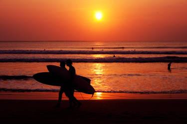 Surfers at Kuta Beach by accessQ
