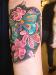 Butterfly and flower tattoo by Nattaxx