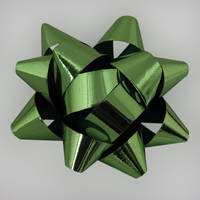 Green Christmas bow by LucieG-Stock