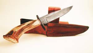 Elk Antler Damascus Hunting Knife by wolfofragnarok