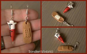 Syringe and bandage earrings by Sandien