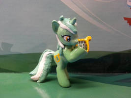 Lyra playing the lyre by balthazar147