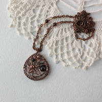 Copper pendant with garnet by WhiteSquaw