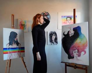 With my rainbow paintings by ericadalmaso
