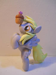 Derpy and edible friend. by EarthenPony