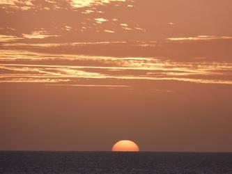 Sunset On Sea by jonvin