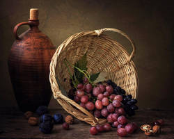 Still life with basket of grapes by Daykiney