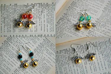 Golden Snitch earrings by nuclearpomegranate