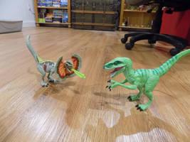Delta vs. Dilophosaurus by tcr11050