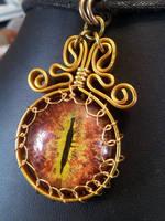 Fire eye in flat gold wire by BacktoEarthCreations