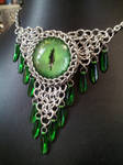 Toxic green eye in chainmaille with green daggers by BacktoEarthCreations