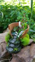 Polymer clay fairy garden by BacktoEarthCreations
